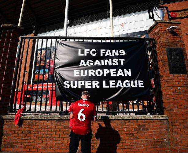Liverpool fans tied banners to the gates of the Kop